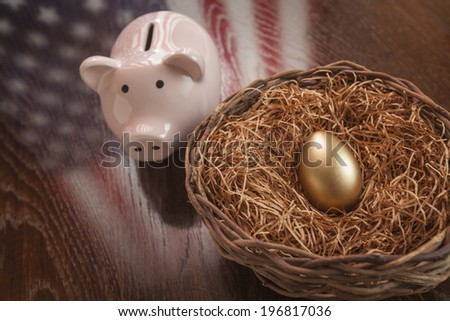 Golden Egg in Nest and Piggy Bank with American Flag Reflection on Wooden Table. - stock photo
