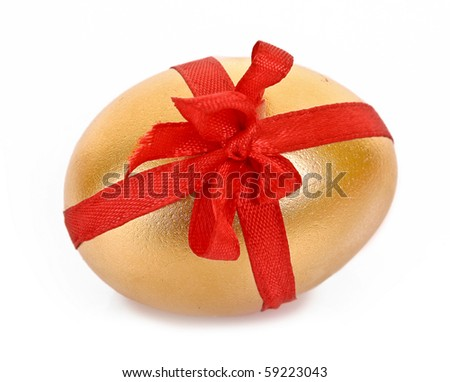 Golden egg with red stripe isolated on white - stock photo