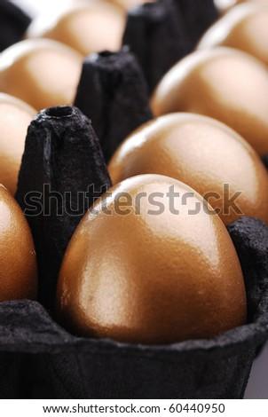 Golden eggs close-up - stock photo