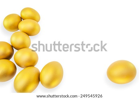 Golden eggs isolated on white background with blank space for adding text: A golden eggs opportunity concept of wealth and a chance to be rich - stock photo
