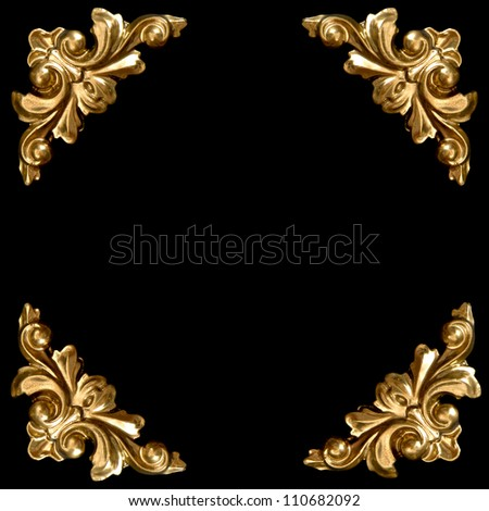 golden elements of carved frame on black background - stock photo