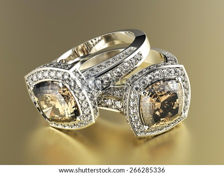 Golden Engagement Ring with Cognac Diamond. Jewelry background - stock photo