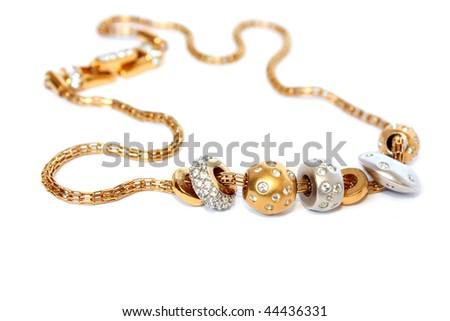 golden feminine jewelry isolated on white - stock photo