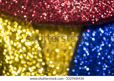 Golden Festive  background. Abstract twinkled bright background with bokeh defocused blur gold lights. Valentines Day, Party, Christmas background. - stock photo