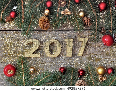 golden 2017 figure on a christmas decoration on wooden background