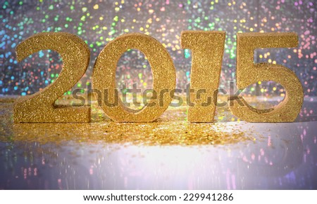 golden figures 2015 on a colorful bokeh background - stock photo