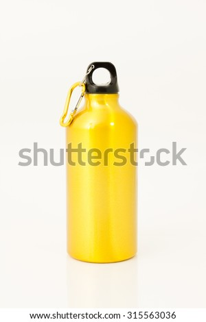 Golden flask isolate on white background - stock photo