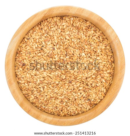 Golden flax seeds in wooden bowl isolated on white background. Flax seeds are rich in omega-3 fatty acid. Top view. - stock photo