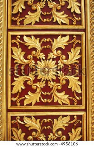 golden flower repeat on door - stock photo