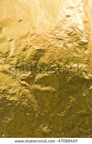Golden foil abstract texture - stock photo