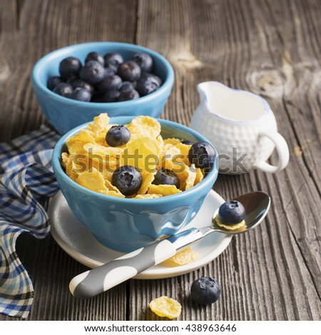 Golden fragrant twisted baguettes on a simple wooden background on a white towel in blue cage with olive oil and honeycombs. The concept of simple rustic healthy homemade food - stock photo