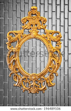 golden frame and black white brick wall - stock photo