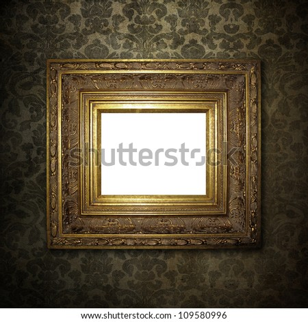 Golden frame over grunge wallpaper - stock photo