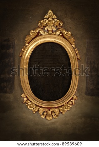 Golden frame over vintage wallpaper - stock photo