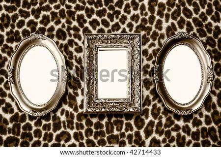 Golden frames on leopard skin background - stock photo