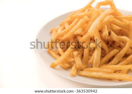 Golden French fries potatoes on white