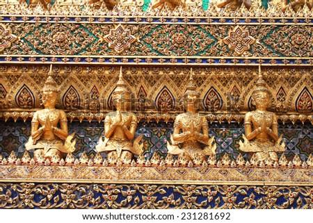 Golden garuda sculptures at Temple - stock photo