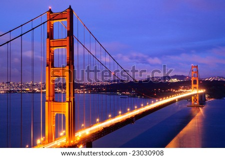 Golden Gate Bridge after a winter storm glows against the background of San Francisco and Twin Peaks tower, shot from Battery Spencer (Marin Headlands) at dusk. - stock photo