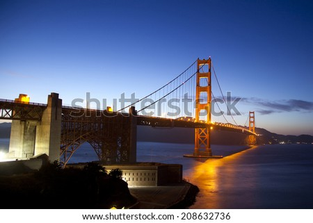 Golden Gate Bridge after sunset on a clear day