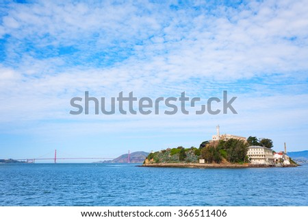 Golden Gate bridge and Alcatraz from SF bay - stock photo