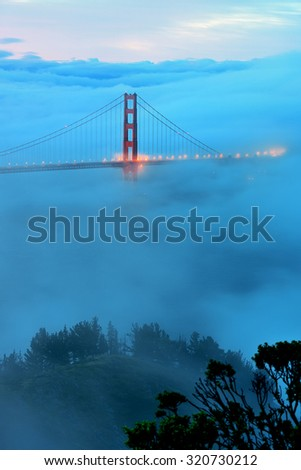 Golden Gate Bridge and fog in San Francisco viewed from mountain top