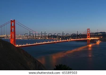 Golden Gate Bridge and San Francisco city lights - stock photo