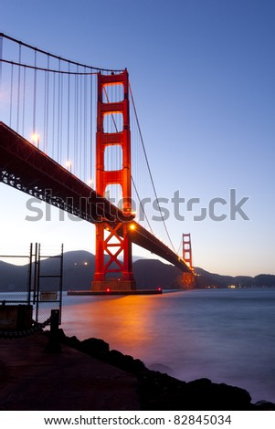 Golden Gate bridge at night with long shutter speed, long exposure photography. - stock photo