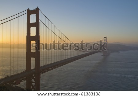 Golden Gate Bridge at sunrise with dramatic sky