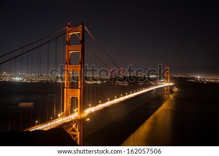 Golden Gate Bridge by night - stock photo