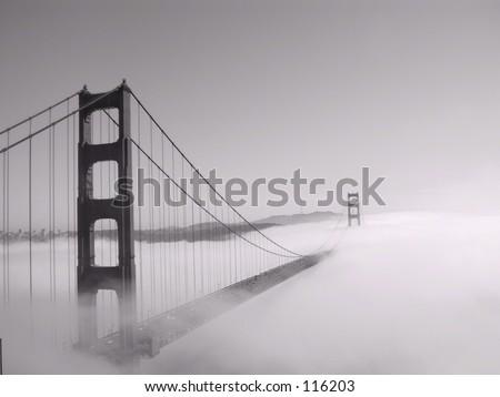Golden Gate Bridge in fog, San Francisco, California (black and white) - stock photo