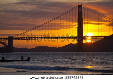Golden Gate Bridge in San Francisco at Sunset over the Pacific Ocean - stock photo