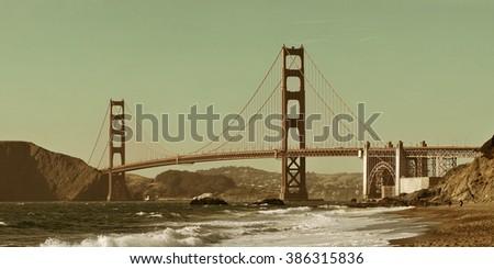 Golden Gate Bridge panorama at Baker Beach in San Francisco as the famous landmark. - stock photo