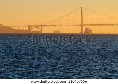 Golden Gate Bridge Skyline with tanker silhouette in San Francisco, USA - stock photo