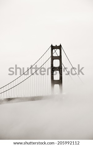 Golden Gate Bridge tower in fog closeup in San Francisco - stock photo