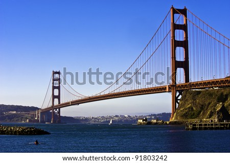 Golden Gate bridge with sculling boat