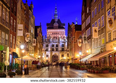 Golden Gate on the pedestrian central street in the old town of Gdansk in the evening, Poland - stock photo