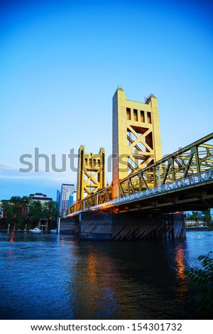Golden Gates drawbridge in Sacramento at sunset - stock photo