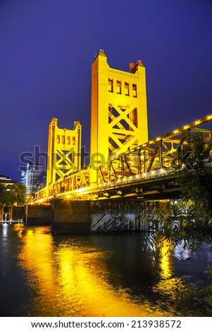 Golden Gates drawbridge in Sacramento at the night time - stock photo