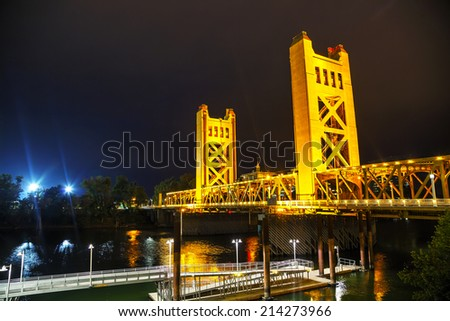 Golden Gates drawbridge in Sacramento at the night time - stock photo