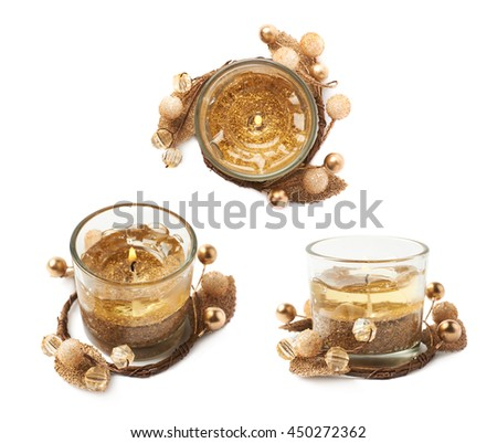 Golden gel candle decorated with a Christmas wreath, composition isolated over the white background, set of three different foreshortenings
