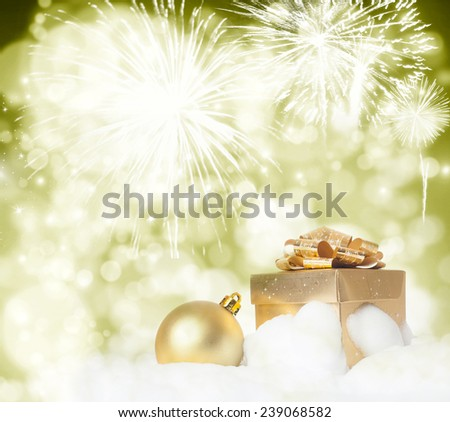 Golden gift box on holiday background of fireworks - stock photo