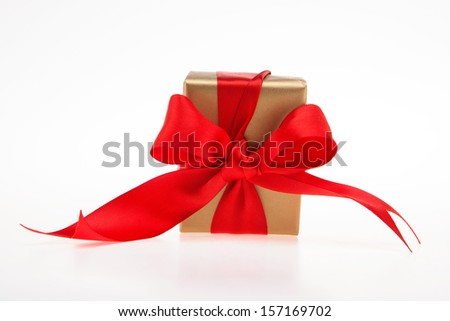 Golden gift box with red large ribbon