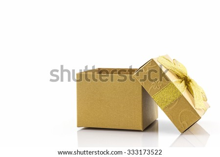 Golden gift box with ribbon bow on white background. - stock photo