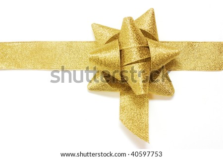 golden gift ribbon and bow isolated over white. some other you may also like - stock photo