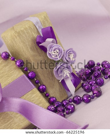 golden gifts in the purple arrangement