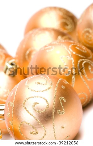 golden glass christmas balls closeup on white background