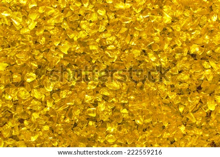 golden glass granules background - stock photo