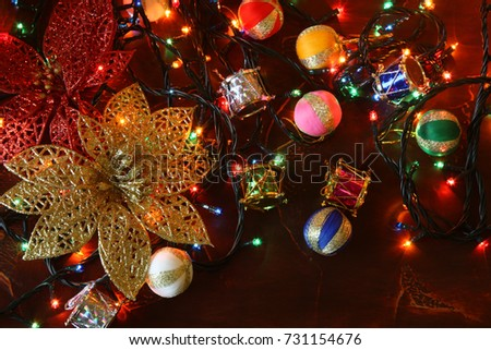 golden glitter flower christmas lights and christmas tree decoration on red background with copy space - Flower Christmas Lights