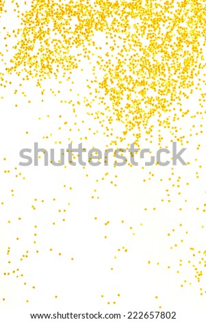 golden  glitter sparkle on white  background - stock photo