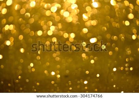 golden glittering bokeh background - stock photo